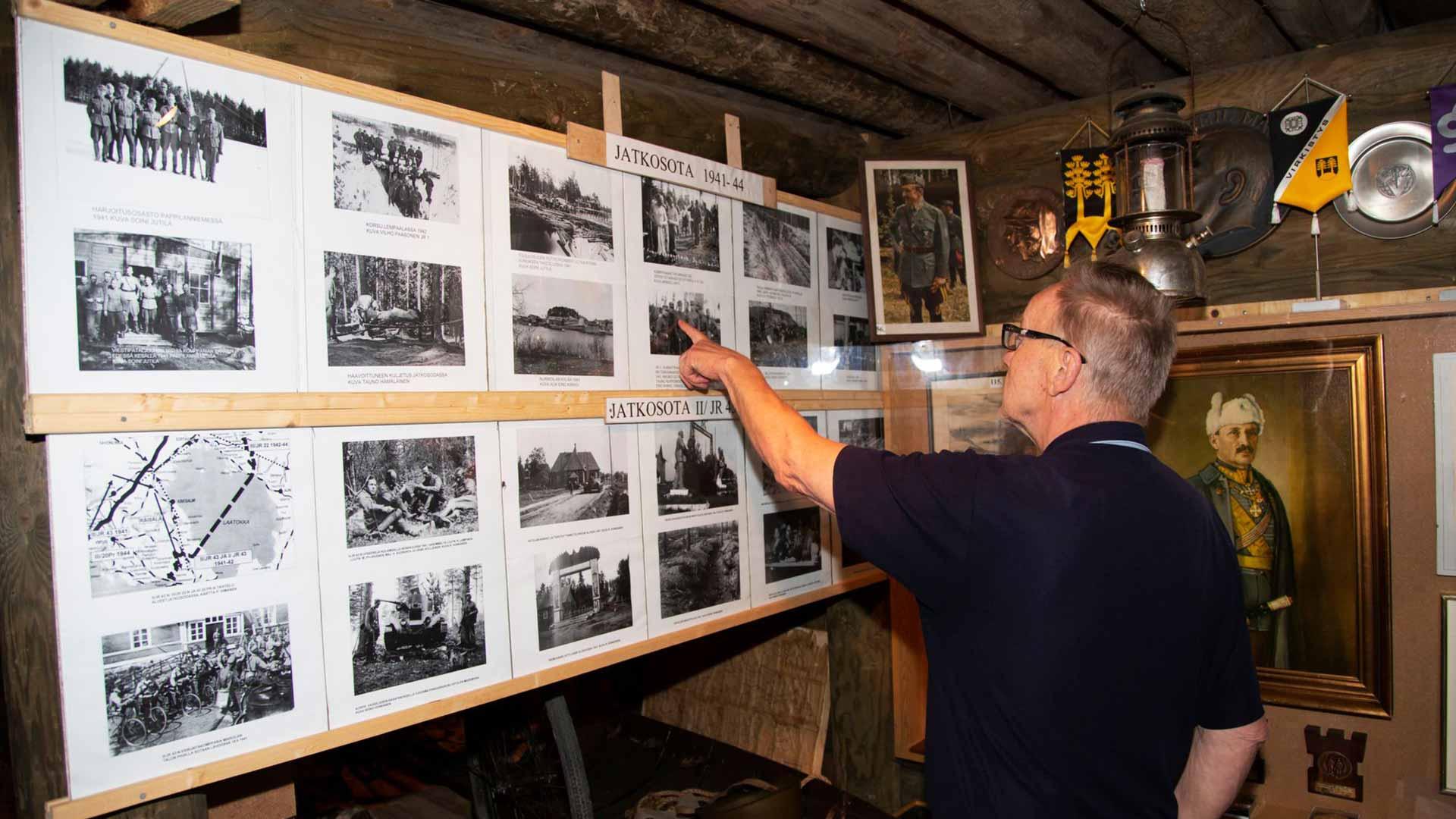 Mäntyharjun veteraanipuisto ja korsumuseo vaalivat veteraanien muistoa ja tarjoavat tietoa niin sisällissodan kuin talvi- ja jatkosodankin vaiheista. Kuvassa Reijo Nupponen esittelee valokuvia.